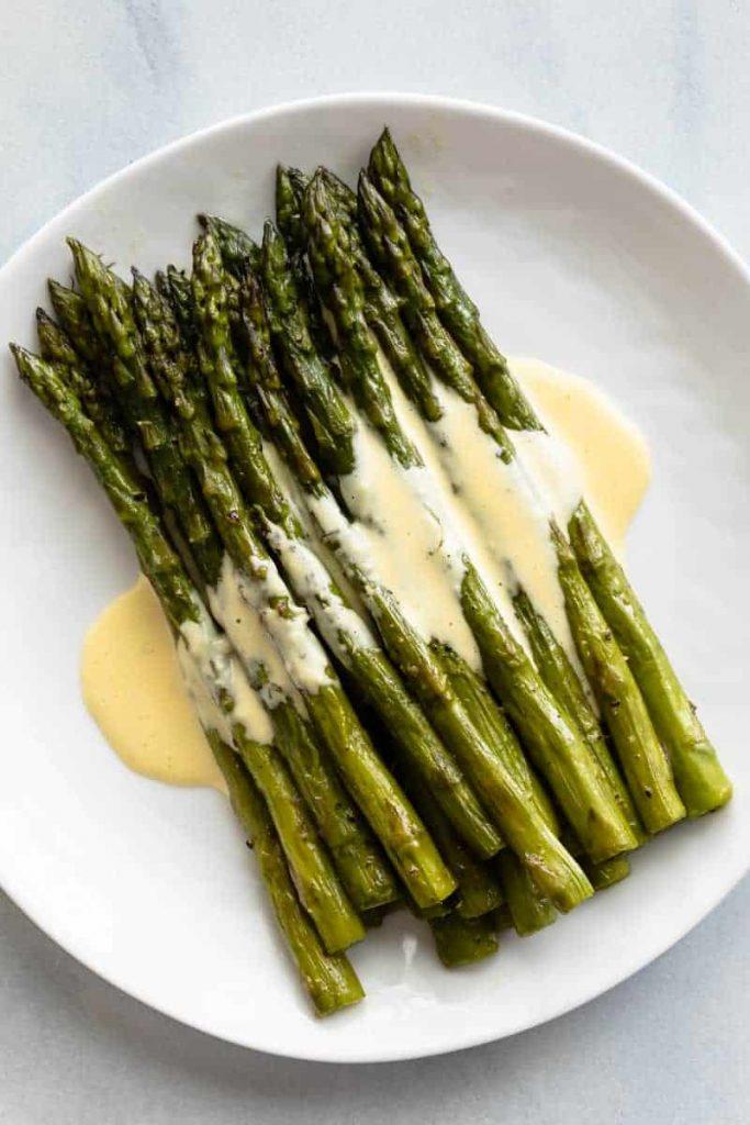 Béarnaise Sauce served over asparagus