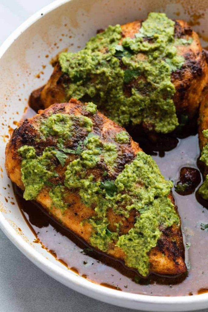 Peruvian Green Sauce drizzled over grilled chicken