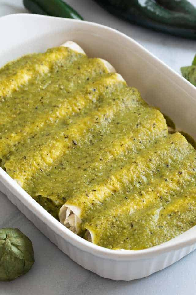 Green Enchilada Sauce over chicken enchiladas